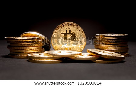 Stacked and piled golden Bitcoins