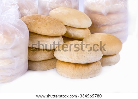 stacked arabic bread on isolated background - stock photo