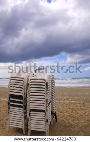 stacked beach chairs on a winter day