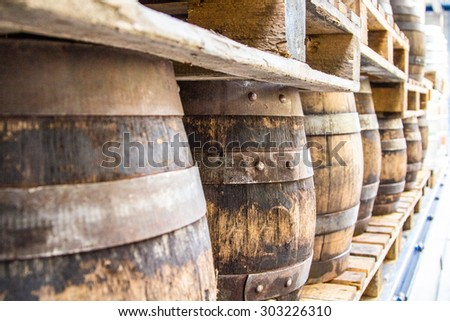 Stacked beer barrels - barrels of beer on the beer wagon - stock photo