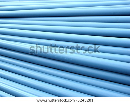 Stacked blue PVC plumbing tubes. - stock photo