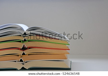 Stacked books on table