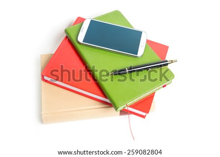 Stacked books, smartphone and pen isolated - stock photo