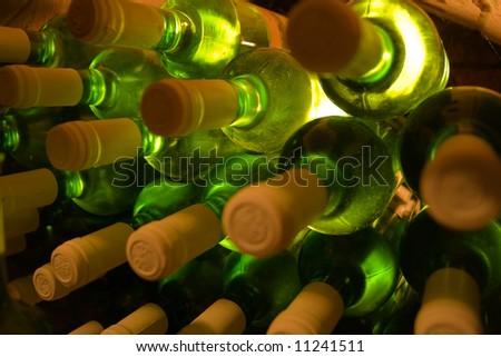 stacked bottles of white wine - stock photo