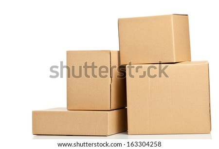 Stacked brown delivery carton boxes on white background