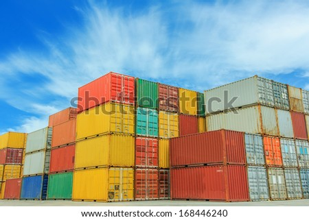 Stacked cargo containers in freight sea port terminal  - stock photo
