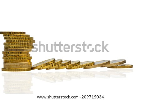 stacked coins and lying, symbol photo for debt, drop in profits and deductions - stock photo