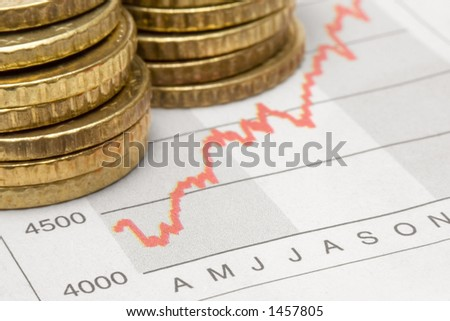 Stacked Coins on Chart - stock photo