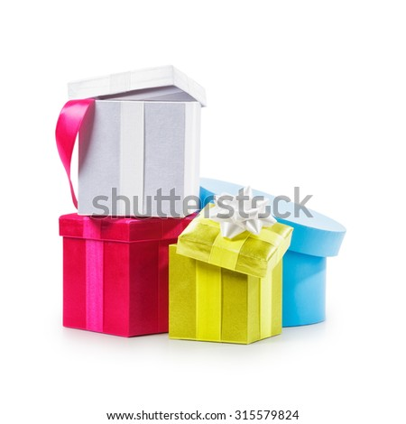 Stacked colorful gift boxes with ribbon bow. Holiday present. Croup of objects isolated on white background. Clipping path - stock photo