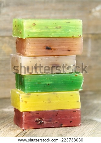 Stacked colorful natural herbal soaps - stock photo