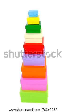 stacked colorful packaging boxes isolated on white background
