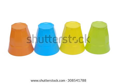 stacked colorful plastic cups on white background