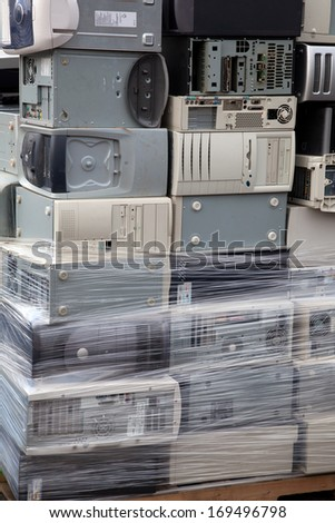 Stacked computers sorted and wrapped on a palette for electronic recycling - stock photo