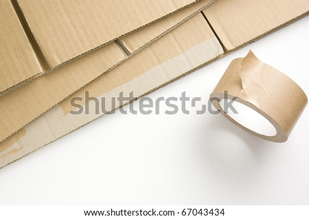 Stacked corrugated and adhesive tape - stock photo