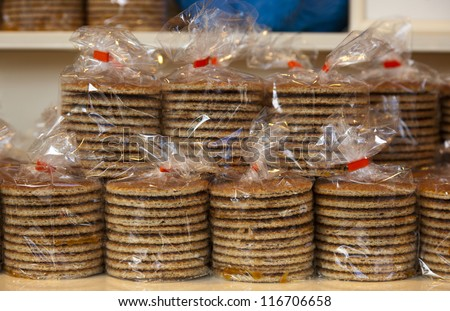 stacked Dutch waffles called a stroopwafel in a shop - stock photo