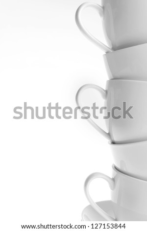 stacked empty white coffee cups, Isolated - stock photo
