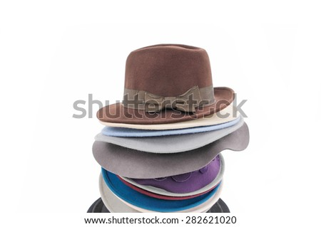 Stacked fedora hat isolated on white - stock photo