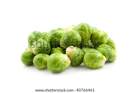 Stacked fresh Brussels sprouts isolated on white background