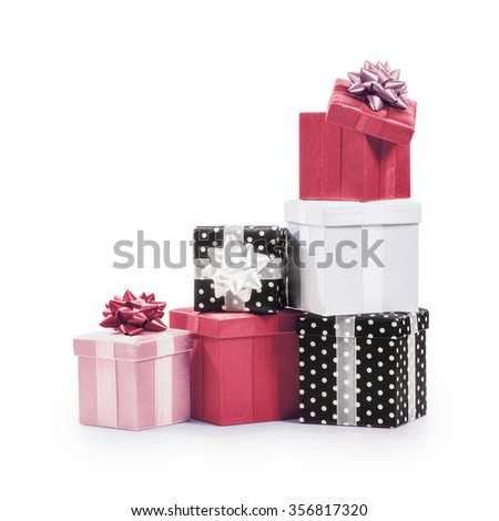 Stacked gift boxes with ribbon bow. Holiday present. Croup of objects isolated on white background. Clipping path