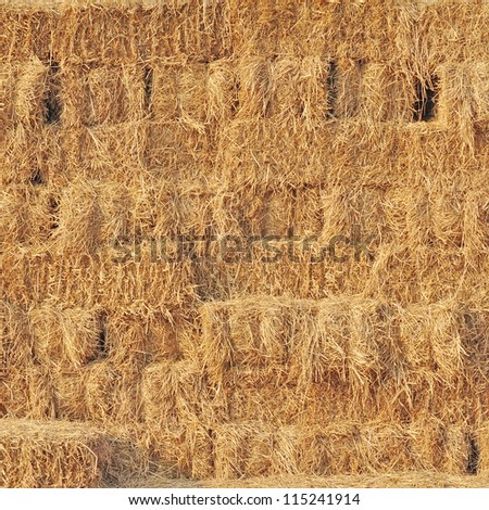 Stacked hay bales for background - stock photo