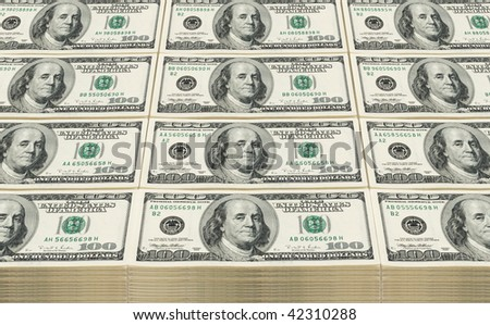 Stacked Hundred dollars.  Can be used as background.