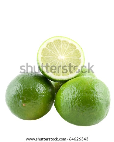 stacked limes one is sliced