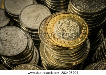 Stacked Mexican Peso Coins - stock photo
