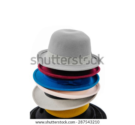Stacked of hat on white background - stock photo