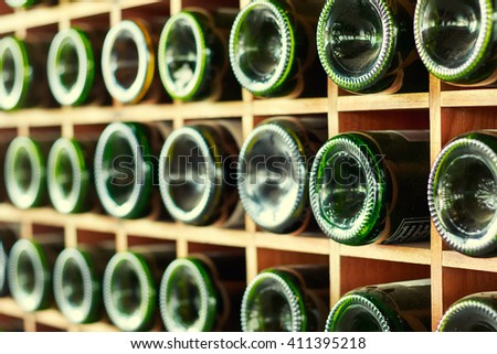 stacked of old wine bottles in the cellar