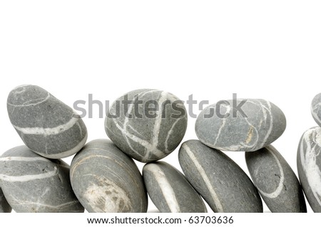 Stacked of striped pebbles - stock photo