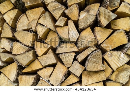Stacked of wood log for  for the stove, background and texture. - stock photo