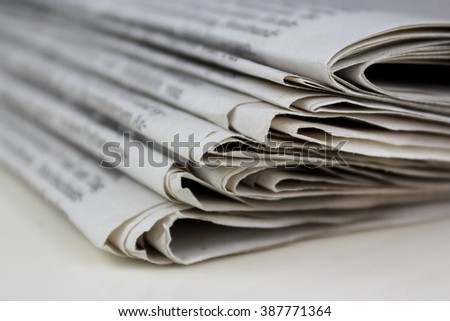 stacked old newspapers pile of newspapers - stock photo