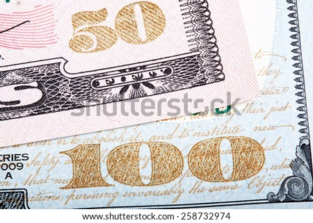 Stacked photo. Detail of new design of 100 and 50 dollars (banknote) bills. - stock photo