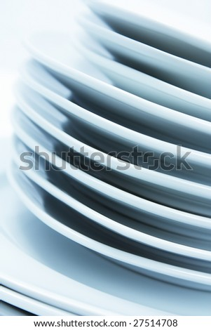 Stacked plates on a table - stock photo