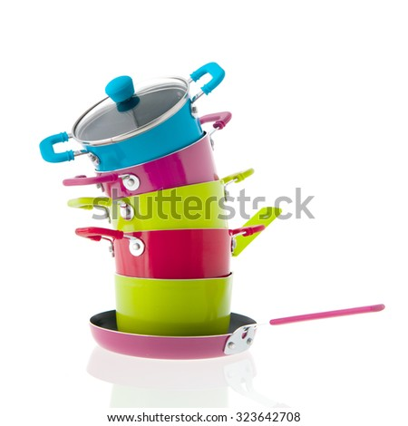 Stacked pots for cooking isolated over white background - stock photo