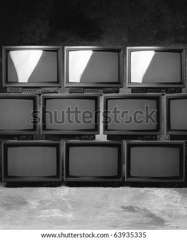 stacked production displays monitors - stock photo