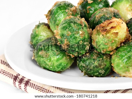 Stacked roasted brussel sprouts, macro side view. - stock photo