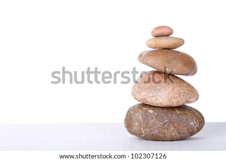 Stacked rocks with an isolated white background