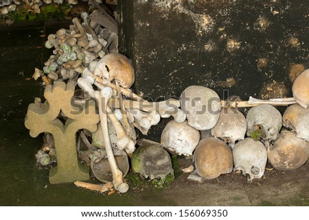 Stacked skulls inside the ossuary of Marville, France, with thousands of ancient skulls of 19th century and older - stock photo
