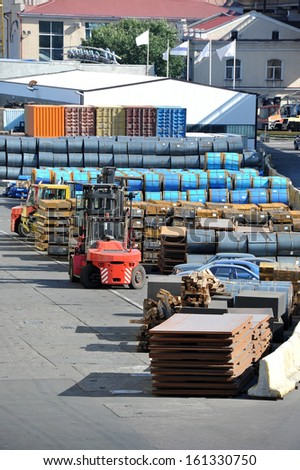 Stacked steel metal sheet and roll, ready for shipment in port