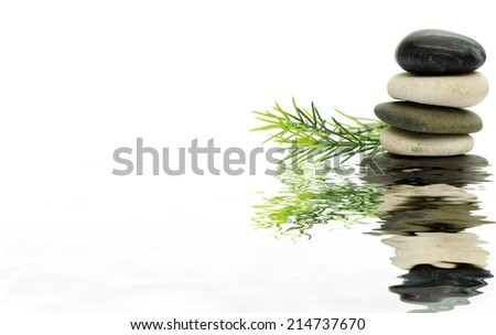 Stacked stone on white background with rosemary : Digital compositing with colour tone, water reflection and ripple effects - stock photo
