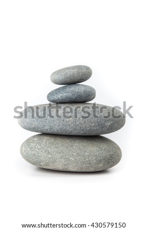 Stacked stones against white background, zen. Concept of balance and harmony. - stock photo