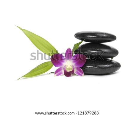 stacked stones and pink orchid and bamboo leaf - stock photo