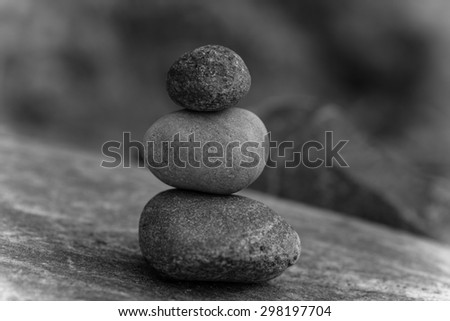 Stacked stones on a natural background. zen background - stock photo