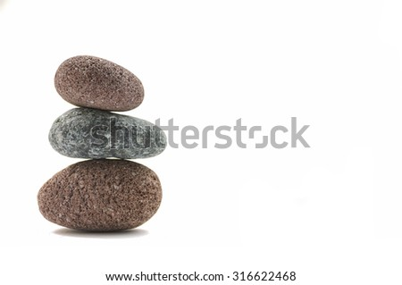 Stacked three stone isolated - stock photo
