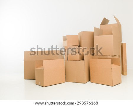 stacked up moving boxes in empty house. copy space available - stock photo