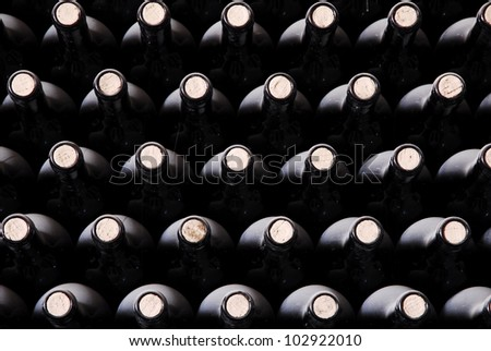 stacked up wine bottles - stock photo