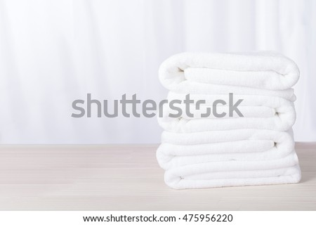 Stacked white  plush spa hotel towels