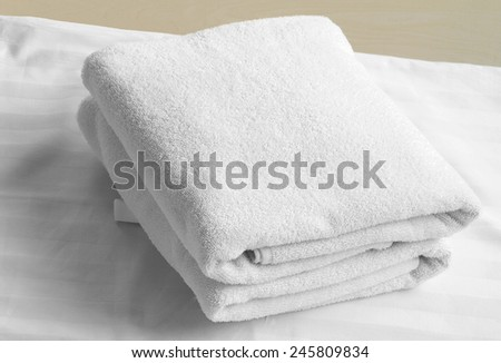 Stacked white spa cloth beach towels. - stock photo