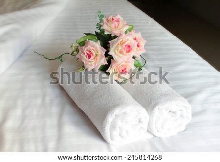 Stacked white spa towels romantic.  - stock photo